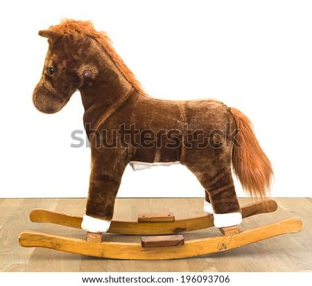 Rocking Horse on wood white background - stock photo