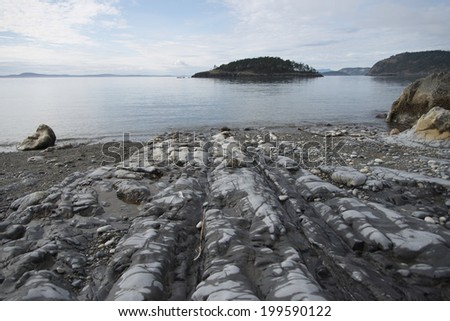 Rocks along shoreline, Deception Pass State Park, Oak Harbor, Washington State, USA - stock photo
