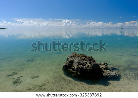 Rocks along the shallow of the crystal clear waters of the Florida Keys - stock photo