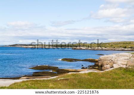 Rocks along the shore of Peggys Cove - stock photo