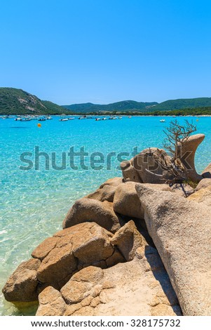 Rocks and crystal clear turquoise sea water of Santa Giulia beach, Corsica island, France