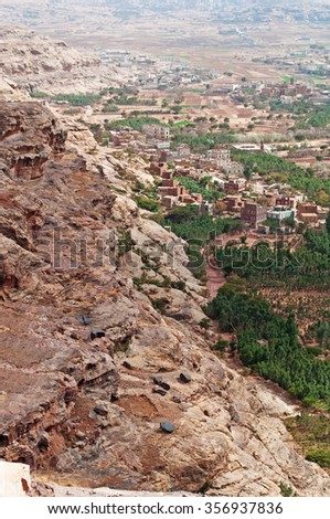Rocks and decorated old houses, overview of Shibam valley seen from Kawkaban, northwest of Sanaâ??a, fortified city, cities, village, street, Republic of Yemen, daily life - stock photo