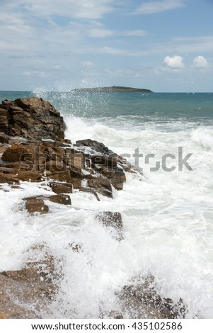 rocks and wave - stock photo