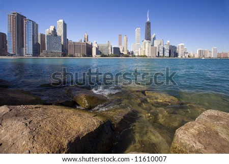 Rocks and waves  - Gold Coast in Chicago, Il. - stock photo