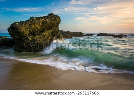 Rocks and waves in the Pacific Ocean at sunset, at Thousand Steps Beach, in Laguna Beach, California.