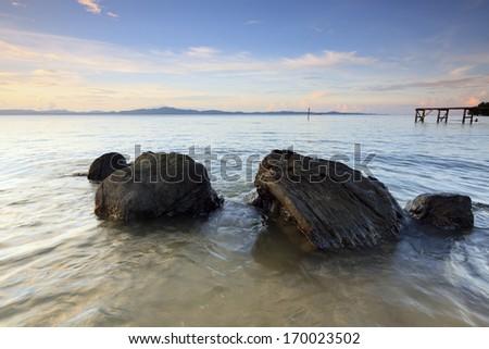 Rocks at a tropical beach in Sabah, Borneo, Malaysia - stock photo