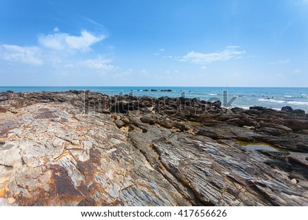 Rocks at tropical beach and beautiful sea, Nature background.