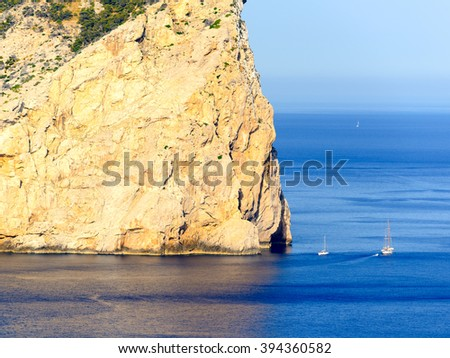 Rocks Cape Formentor from the emerald water of the Mediterranean Sea and small yachts. Majorca. Balearic Islands. Spain - stock photo