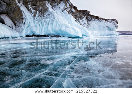 Rocks frozen into the ice of siberian Baikal Lake in winter - stock photo