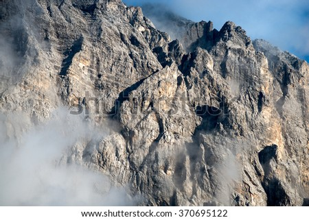 Rocks in the clouds, the Alps and the stones, landscape - stock photo