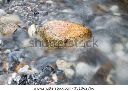 rocks in the river in nature - stock photo