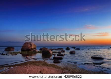 Rocks in the sea at sunset in Lahemaa nature park, Estonia - stock photo