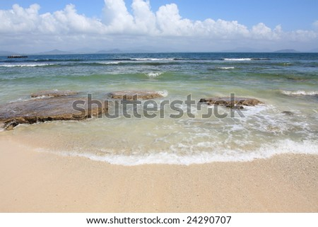 Rocks in the sea with small wave taken at Sanya, China - stock photo