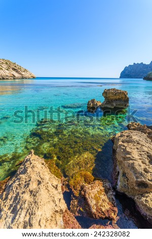 Rocks in turquoise sea water in Cala San Vicente, Majorca island, Spain
