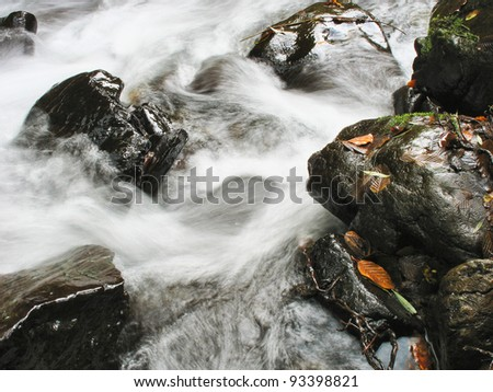 rocks in water - stock photo