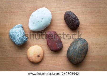 Rocks isolated on wood background  - stock photo
