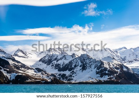 Rocks of Antarctica covered with snow - stock photo