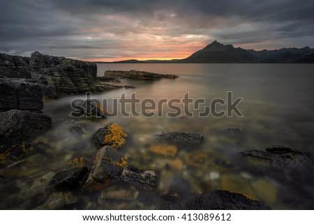 Rocks of Loch Scavaig near Elgol in sunset light, Skye, Scotland - stock photo