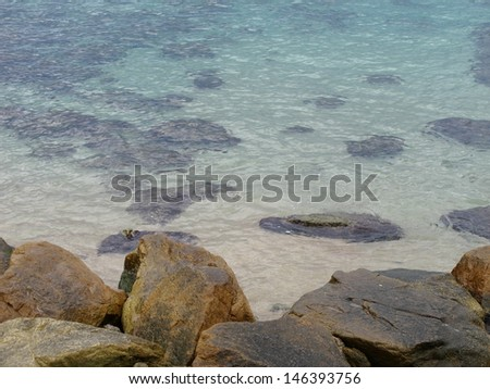 Rocks on shore and  underwater  - stock photo