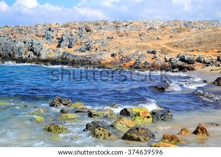 Rocks on the coast of Aegean Sea in Malia, Crete, Greece. - stock photo