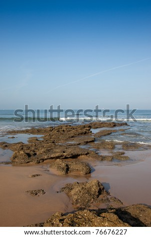Rocks on the seashore of a beautiful beach