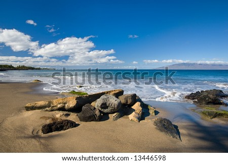 Rocks on tropical beach - stock photo