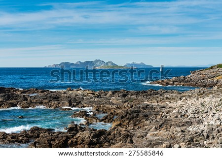 Rocks, sea and boat in Baiona, Pontevedra, a tourist town with a medieval historical center located in the Ria de Vigo.