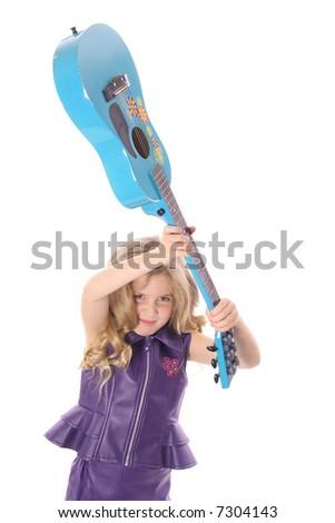 rockstar child smashing her guitar peek - stock photo