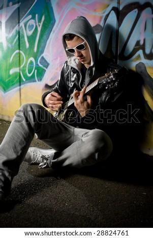 rockstar on the street - stock photo
