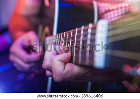 Rockstar Playing Live solo on Guitar - stock photo