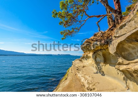 Rocky beach and ocean scenic for vacations and summer getaways. Famous Galaspina Rock Gallery at Gabriola Island, BC, Canada. - stock photo