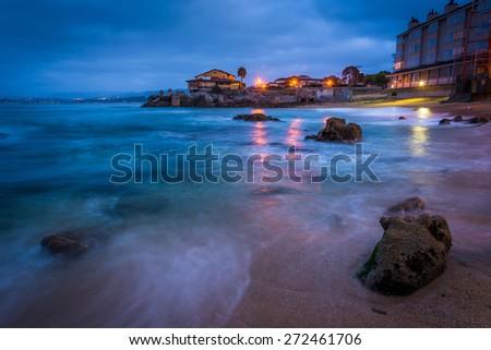 Rocky beach at twilight, in Monterey, California. - stock photo