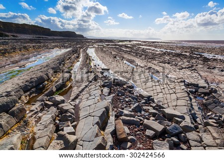 rocky beach near Kilve, Somerset, England, known for the many fossils - stock photo