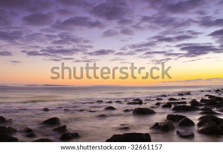 Rocky beach sunrise - stock photo