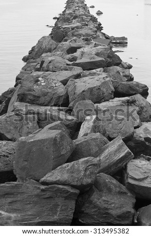Rocky boulder pier or wharf on lake Ontario at Toronto Island, Canada. - stock photo
