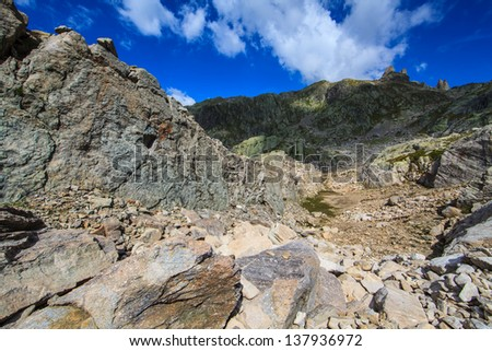 Rocky cliffs and formations in the French Alps in summer - stock photo