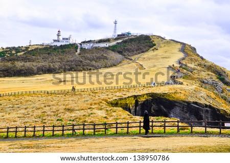 Rocky cliffs in Udo island, Korea. Udo is a small and famous tourist island near Jeju island, South Korea - stock photo