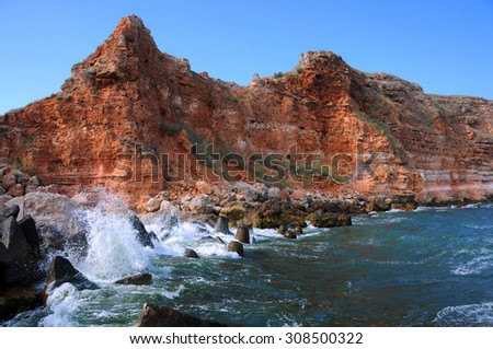 Rocky coast and waters of Bolata beach in Bulgaria - stock photo
