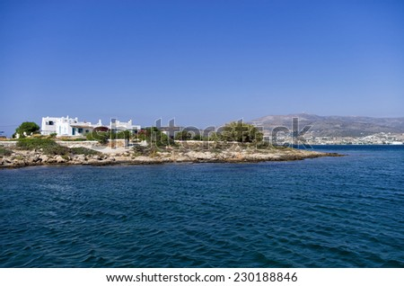 Rocky coast and white houses in Antiparos island, Greece - stock photo
