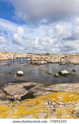 Rocky coast at sea archipelago - stock photo