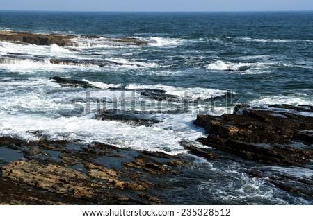 Rocky coast at the Atlantic ocean, Ireland - stock photo