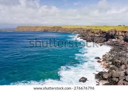 Rocky coast line of Big Island, Hawaii on a cloudy day. - stock photo