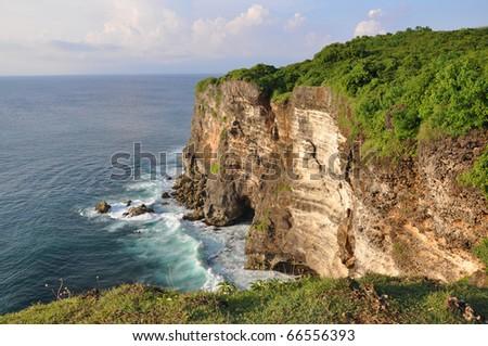 Rocky coast near Uluwatu temple on Bali, Indonesia - stock photo