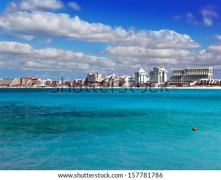 Rocky coast, the sea and city in the distance - stock photo