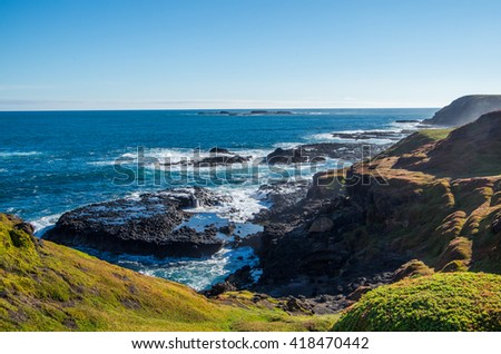 Rocky coastline at The Nobbies rock formation on Phillip Island in Victoria, Australia. - stock photo