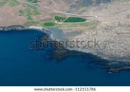 rocky coastline from above - stock photo