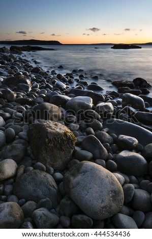 Rocky Coastline of Maine at Sunrise - stock photo