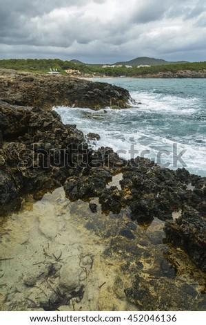 Rocky coastline of Mediterranean Sea ibiza,Spain,summer - stock photo