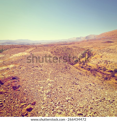 Rocky Hills of the Negev Desert in Israel, Vintage Style Toned Picture - stock photo