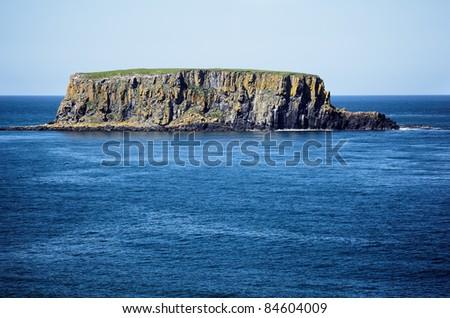 Rocky island in the sea , Northern Ireland - stock photo
